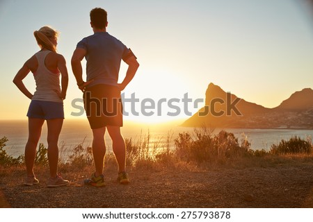 Man and woman contemplating after jogging - stock photo