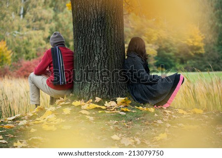 Man and woman contemplating in the autumn park - stock photo