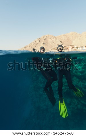 man and woman divers ready to dive - stock photo