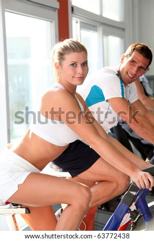 Man and woman doing indoor biking