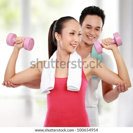 man and woman doing sport in the gym - stock photo