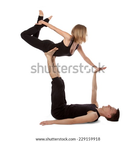 Man and woman doing yoga on white background - stock photo