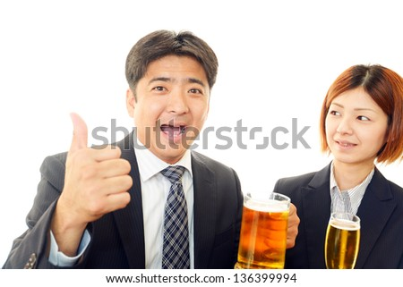 Man and woman drinking beer - stock photo