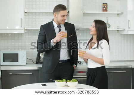stock photo man and woman drinking juice at the kitchen wearing formal wear having a pleasant talk informal 520788553 Mail Order Star of the wedding Pricing