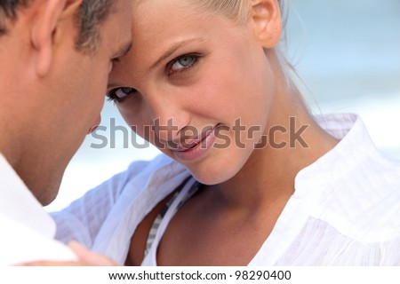 Man and woman embraced - stock photo