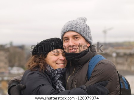 Man and woman embracing in a cold day