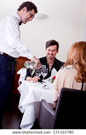 http://thumb1.shutterstock.com/display_pic_with_logo/942481/131165780/stock-photo-man-and-woman-for-dinner-in-restaurant-waiter-serving-mineral-water-131165780.jpg
