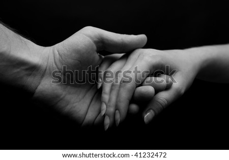 Man and woman hands. B&W - stock photo