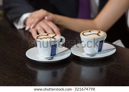 man and woman hands. love and cup coffee concept - stock photo