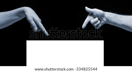 Man and woman hands pointing on empty blank white copy space on black background. - stock photo