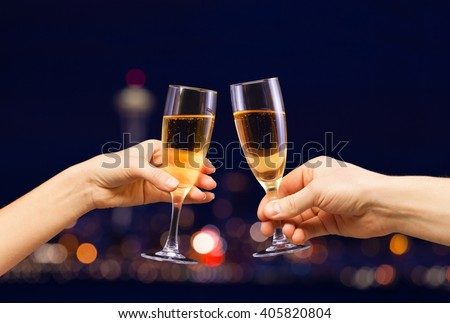 Man and woman hands with full champagne glasses - stock photo