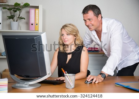 Man and woman happy to work at office