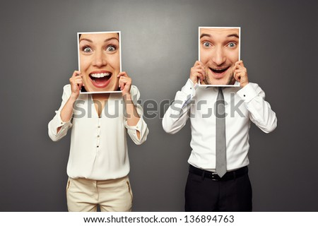 man and woman holding amazed happy faces. concept photo over grey background