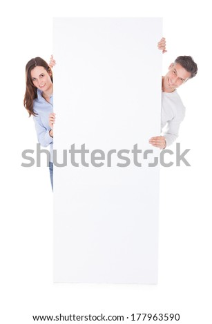Man And Woman Holding Blank Billboard Over White Background - stock photo