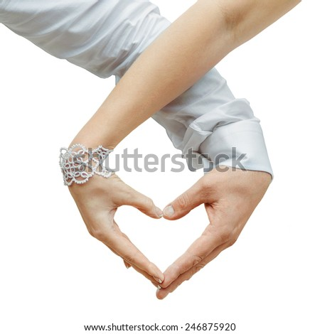 Man and woman holding by hands and making love heart  isolated on white background - stock photo