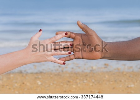 Man and woman holding each otherâ??s hand (symbol of love and diversity)
