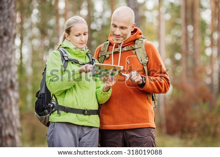 Man and woman holding map in hands, argue where to go.  - stock photo