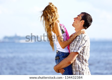 man and woman hug in the sky and sea on sea - stock photo