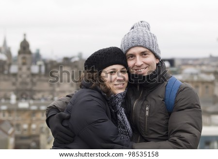 Man and woman hugging smiling - stock photo