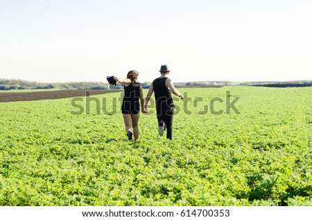 man and woman in a meadow