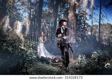 Man and woman in a mystical forest. The mystical atmosphere, haze, forest.