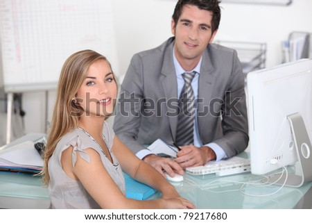 man and woman in an office - stock photo