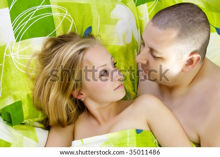 Man and woman in bed. - stock photo