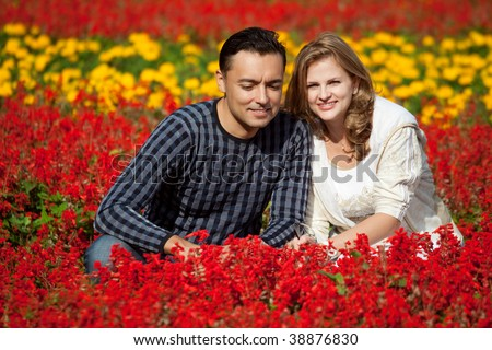 man and woman in braces in flowering park - stock photo