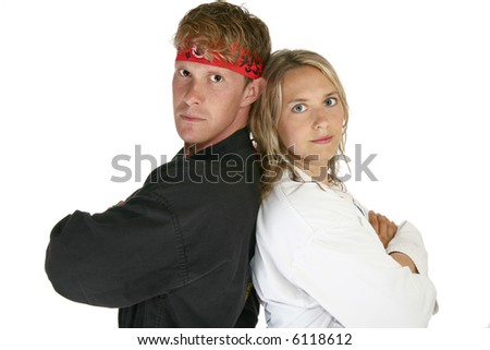 Man and woman in martial arts uniforms back to back - stock photo