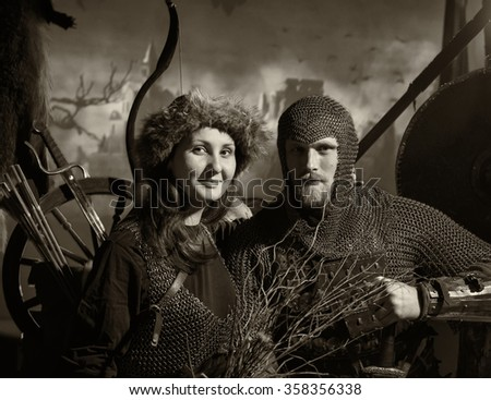 Man and woman in medieval costumes - stock photo