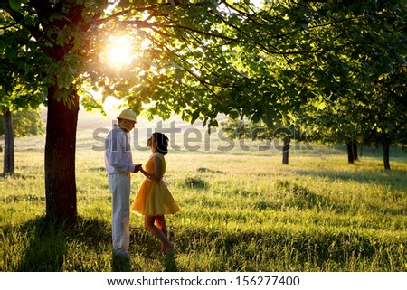 man and woman in sunset inthe park