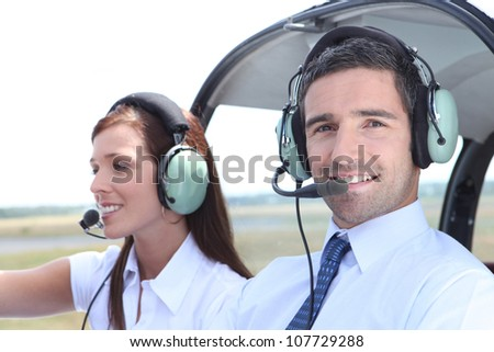 Man and woman in the cockpit of a light aircraft waiting for takeoff - stock photo