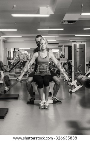 Man and woman in the gym. The coach and client to sports training. Sport, fitnesss, healthy lifestyle. - stock photo
