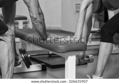 Man and woman in the gym. The coach and client to sports training. Sport, fitnesss, healthy lifestyle.