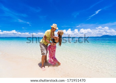 man and woman in the turquoise sea on the Philippine island