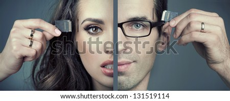 man and woman inserting SD cards - stock photo