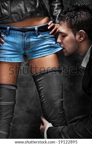 man and woman, intimate moments, studio dark - stock photo