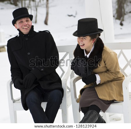 Man and woman laugh over some silly joke