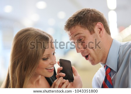Man and woman listening to gossip at the office