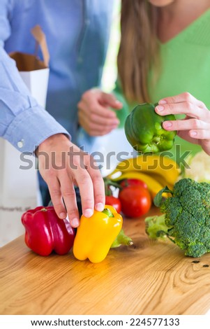 Man and woman living vegetarian and healthy by eating fruits and vegetables