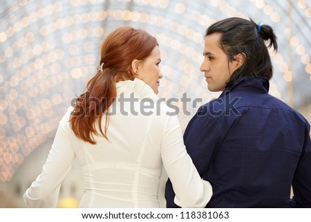 Man and woman look one each other, view from behind