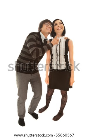 Man and woman looking up and smiling - stock photo