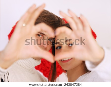 Man and woman made heart with their hands - stock photo
