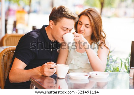 man and woman on a date at a cafe