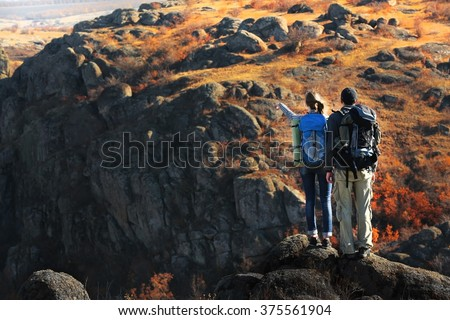 Man and woman on the top of the mountain - stock photo