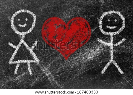 Man and woman painted on school board - love background - stock photo