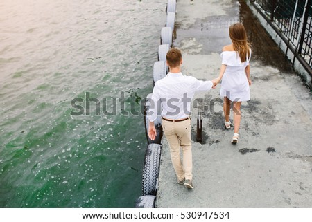 man and woman posing on the lake at the camera