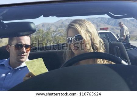 Man and woman reading ticket - stock photo