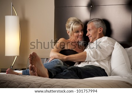 Man and Woman Relaxing in a Hotel Room - stock photo