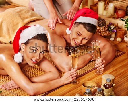 Man and woman relaxing in Christmas spa.